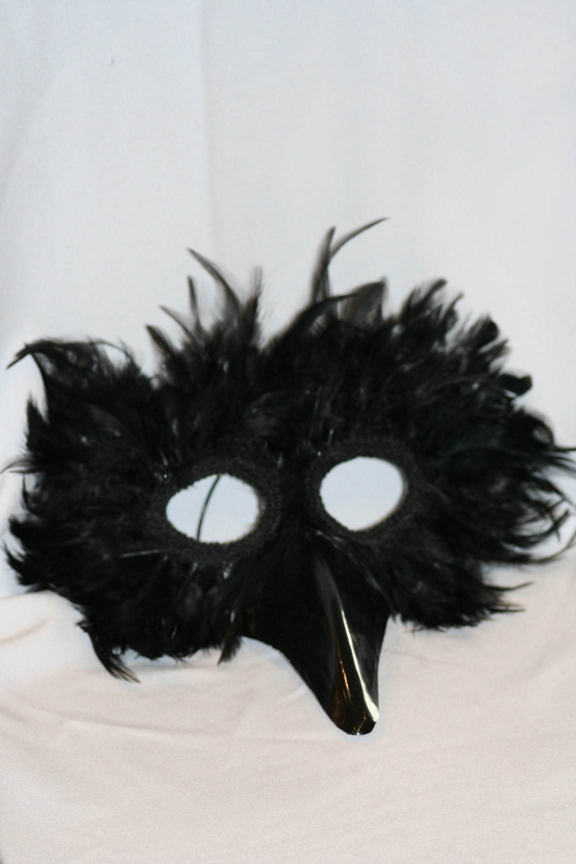 how to clean feathers on a mask